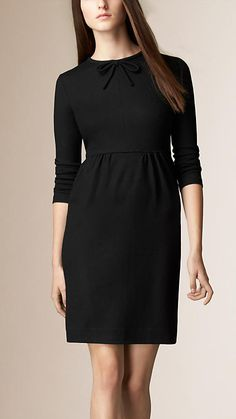 Burberry Black Bow Detail Wool Dress - A gently defined wool dress with feminine bow detail. The simple shape features a fitted waist with gathered detail, set-in sleeves and a classic crew neck. Discover the women's dress collection at Burberry.com