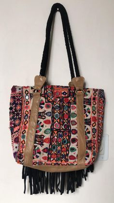 Beautiful boho banjara embroidered handcrafted bag perfect for office or shopping day out! Accessorise it up with a white shirt and blue jeans. White Shirt And Blue Jeans, Bohemian Theme, Hippie Bags, Embroidered Bag, Shopping Day, Amulets, Vintage Coat, Cute Bags, Embroidery Techniques