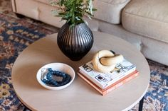 The Basics of Coffee Table Styling - Shades of Blue Interiors Living Room Candles, Table Decor Living Room, Room Decor, Coffee Table Styling, Decorating Coffee Tables, Blue Interiors, Small Potted Plants, Blue Candles, Round Coffee Table