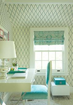 Wow of a workspace. Simple and white decor let the bold pattern make a big statement in this home office. Expand the height of the ceiling by running the wallpaper from floor to the top of the knee wall which turns this smaller space into something special and sophisticated. Finish the room with all white furniture, pretty turquoise accessories and a silver table lamp that complement the pattern without competing against the strong lattice motif.