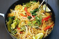 Singapore Noodles recipe made from rice vermicelli, curry powder, bean sprouts, bok choy, snow peas, and other yummy ingredients. Vegan & Gluten-Free!