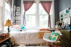 A charmingly cluttered bedroom with colours. Mixing vintage with design