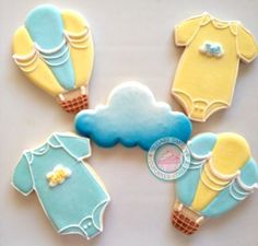 Baby Hot Balloons~                     By SugarySweetCookies, teal, yellow, blue. Up, Up and Away... A new baby is on the way!Sweet cookie set is that perfect touch of delicate detail...Handmade and hand decorated cookies made just for your event.Set comes with 4 of each of the 3 designs shown:-Onesies (3in)-Clouds (3in)-Hot Air Balloons (3in)You may choose up to 3 color combinations. Cookies come individually sealed and wrapped for max freshness and protection.