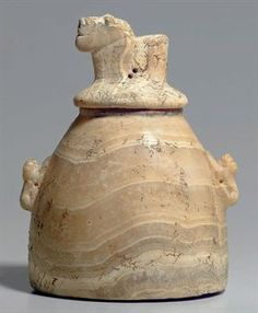 "A SOUTH ARABIAN ALABASTER LIDDED ""BEEHIVE"" JAR CIRCA 3RD CENTURY B.C.-1ST CENTURY A.D."