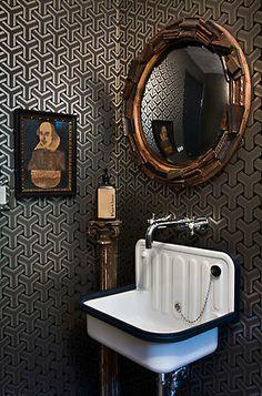 powder room vintage sink, black and gold wallpaper
