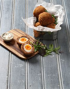 BOBOTIE-SPICED SCOTCH EGGS - A local take on a British classic, these bobotie bombs are the perfect picnic fare. Try it today for 6 Scotch eggs with a proudly South African flavour. Lunch Recipes, Easy Recipes, Healthy Recipes, Jenny Morris, Scotch Eggs, Quick Easy Meals, Allrecipes, Picnic, Spices