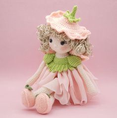 This is a finished handmade amigurumi crochet doll of a sweet Phlox flower fairy. She wears a beautiful peach chiffon skirt topped with crochet leaves made to look like a Phlox flower. On her back are little peach leaf wings and on her head of curls is a removable floral hat. Her shoes were made to match her outfit and have two little crochet leaves on each shoe for embellishment. Please note that this fairy doll is not made to stand and has knees that bend. This Phlox flower fairy was…