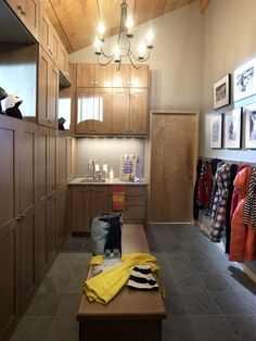 """Stylish """"Mud Room"""" - The first room one enters after a day on the slopes, the mudroom boasts floor-to-ceiling, locker-style maple cabinetry that houses ski equipment, outerwear and accessories. Via HGTV Dream Home 2011: Mudroom Pictures"""