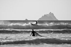 Surfing at St Finian's Bay, overlooking Skellig Rocks, County Kerry , Ireland.