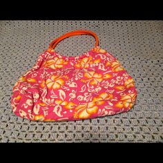 Hawaiian flower beach bag Bright pink, orange, and yellow beach bag with 2 interior pockets! Pre-loved but still in good condition :) Questions and Offers welcome!  **$8 w/ Free shipping on Merc. Bags Satchels