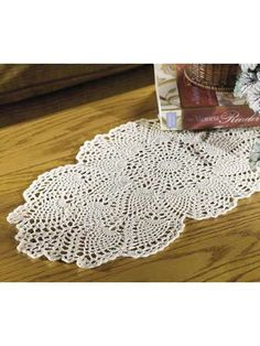 The elegance of fine crochet is captured with this beautiful coffee-table accent. This classic piece has an ageless charm that fits your decor as easily as it might have in generations past. Crochet Dollies, Crochet Quilt, Crochet Home, Thread Crochet, Crochet Crafts, Crochet Yarn, Crochet Projects, Crochet Table Topper, Table Topper Patterns