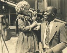 """Shirley Temple holding gift of Griesbaum custom made figure from friend, Bill """"Bojangles"""" Robinson. Photos, figures and more will be in traveling exhibit then in auctioned by Theriault's on July 14, 2015. http://www.theriaults.com"""