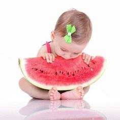 Even little ones know how good a watermelon is. And she doesn't look like she wants to share. So cute !