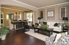 Cozy Great Room with beautiful archways leading into formal dining room! #cozy #archways
