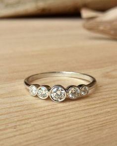 Petite 5 Stone Bezel Set Diamond Band by kateszabone on Etsy https://www.etsy.com/listing/122011853/petite-5-stone-bezel-set-diamond-band
