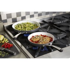 The Simply Calphalon® omelet pans in this set feature a durable ceramic nonstick cooking surface for easy food release, low-fat cooking and fast cleanups, as well as hard anodized aluminum construction for quick and even heating.