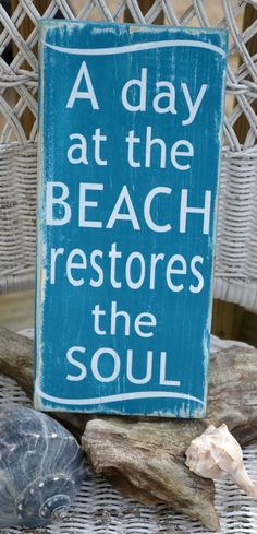 A Day At The Beach Restores The Soul, Beach Decor, Handpainted (No Vinyl) Reclaimed Beach Wood Sign. $25.00, via Etsy.