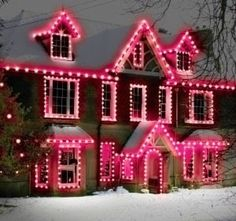 House all lit up in pink Christmas lights