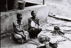Women of the remote village in which we do our work passing the day preparing food.