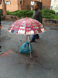 This very sweet man was selling earrings on the street near the metro stop. We were so impressed by this innovative display for his product. So simple, yet so effective. The umbrella and camera tripod allowed the customer to stand in one place while spinning the umbrella to see all of the earrings from an ideal viewing height