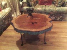 A slice of a tree knocked down by Hurricane Ike was transformed into a coffee table. Photo: Ken Hoffman / HC