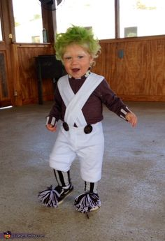 Ashley: Brantlee, 18 months old. I bought white pants, a white turtle neck, white leggings, brown leggings, oversized buttons, brown and white yarn, white fabric paint, orange face paint and green...