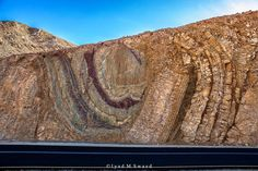 *ISRAEL~AMAZING FOLDING ROCKS: The photo was taken at Eilat mountains, southern Israel......A fold is a rock formation that's been made by flat rocks becoming deformed due to stress and pressure. Folds are created when two plates that make up the earth's crust collide. As the plates are forced together they bend, curve, or make jagged patterns in the rock.