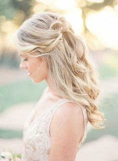 Romantic pinned back hairstyle: http://www.stylemepretty.com/2016/05/26/colorful-kunde-ruins-california-wedding/ | Photography: Emily Scott - http://emily-scott.co/