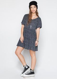 Beanies and Chucks are a cool way to make a girly dress casual.