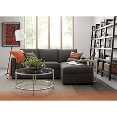Davis 3-Seat Lounger  | Crate and Barrel -- this one can be changed to be a left or a ride side sectional.  Awesome.