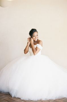 Drooling over this off-the-shoulder ballgown: http://www.stylemepretty.com/2015/09/08/california-pastel-garden-inspired-wedding/ | Photography: Michael Radford - http://www.michaelradfordphotography.com/