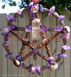 Small handcrafted wood and wire pentacle with smokey quartz crystal, amethyst stone chips, brass owls, and agate stone beads