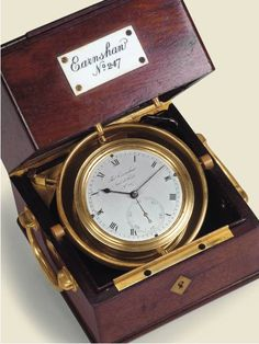 Mahogany, two-day marine chronometer in French style box. Thomas Earnshaw, circa 1795. Thomas Earnshaw, Invenit et Fecit, No. 247, circa 1795. Fine and rare, mahogany, two-day marine chronometer in French style box. C. Brass bowl with threaded glazed bezel, gimbaled in two-body mahogany box with glazed round window in the top under sliding lid, brass handles, corner plate for a key, key-lock in front.D. Silvered, radial Roman numerals, outer minute ring, set eccentrically at the top…