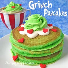 Make Copycat IHOP® Grinch Pancakes for Christmas breakfast. Top fluffy green pancakes with cream cheese icing, green whipped cream, and candy hearts.Fun!