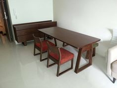 solid wood dining table with bench and stool. Solid wood sideboard
