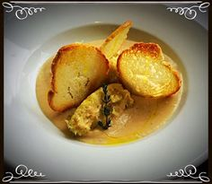 Mashed Cod Chunks served in a Cannellinni Bean Cream and finished with Thyme-infused Olive Oil and Crostini