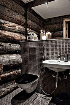Black and wood bathroom. Sink and toilet make it feel like a restaurant bathroom.