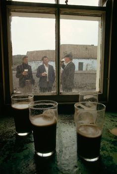 Five O'Clock Somewhere: Livestock traders drink beer outside the only pub on Inishmaan, one of the Aran Islands in Galway Bay off the coast of Ireland. This photo appeard in a 197 National Geographic article. (photography by Winfield Parks, National Geographic)
