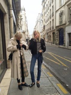 girl in jeans outfit is great; girl in trench coat's shoes are awesome
