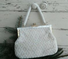 Check out this item in my Etsy shop https://www.etsy.com/listing/498920699/vintage-beaded-purse-1960s-pearly-white