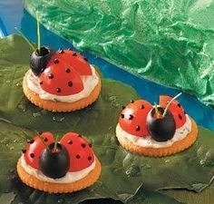 ladybug crackers.. cream cheese, tomatoes and chopped up olives for dots..    www.kiboomu.com/2011/03/21/ladybug-crackers-for-spring/