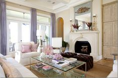 A few accents, like drapery and toss cushions make use of the playful hue without being too cute.