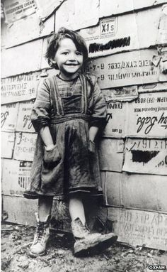 Oxfam campaigned for food aid to be sent to the victims of famine in Greece during WW2.   This photo shows a 'recipient' of that food aid, a lovely little girl who is smiling so brightly you'd think she didn't have a care in the world...