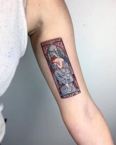 Alfons Mucha inspired tattoo on the left inner arm.