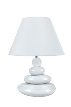 The Tiya table lamp from Lite Source features a stack of four white ceramic stones beneath a white shade.
