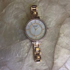 Kate Spade Rose Gold Ladies Watch 100% authentic Kate Spade rose gold watch with mother of pearl dial. Crystal stone bezel and crystals on the face. Gently Preowned excellent condition. Will fit up to 6 1/2 inch wrist. kate spade Accessories Watches