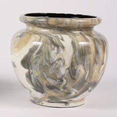 A marbleizing technique involves gently swirling several glazes without fully blending them. Glazes tht are too fluid will continue to blend during firing; Foundations and Stroke & Coat are good to use for marbleizing.