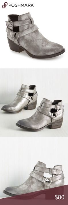 """Born in California BC Communal Cut-Out Bootie BC Footwear: Born in California. New in Box. Stunning and edgy bootie in metallic pewter, extremely comfortable. Vegan leather. A wraparound harness strap details a stylish short boot detailed with striking side cutouts and set on a bold block heel.  2"""" heel (size 8.5). 3 1/2"""" bootie shaft. Adjustable ankle strap with buckle closure. Textile upper/synthetic lining and sole. BC Footwear Shoes Ankle Boots & Booties"""