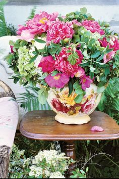 A floral-patterned vase overflowing with fluffy and colorful spring flowers, including lots and lots of bright pink peonies, is the perfect way to welcome spring.
