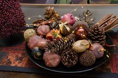 Every year I fill a handmade platter with dried pomegranates, pomanders and subtle ornaments.